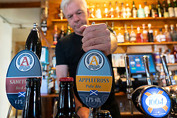 Barman in the Applecross Inn on the North Coast 500 tourist motoring route in northern Scotland, UK