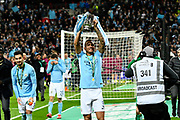 Danilo (3) of Manchester City celebrates with the Carabao Cup at full time after the 3-0 win over Arsenal during the EFL Cup Final match between Arsenal and Manchester City at Wembley Stadium, London, England on 25 February 2018. Picture by Graham Hunt.
