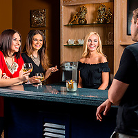 Customers enjoy a drink at May's Lounge, a lounge that offers video gambling in the Chicago area.