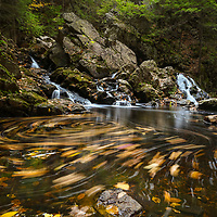 Autumn swirl at Bear&rsquo;s Den in New Salem, Massachusetts, Franklin County. This beautiful waterfall is tugged away in western Massachusetts not far away from Quabbin Reservoir.  It is a cascade type waterfall with a beautiful pool at the bottom of the falls surrounded by steep cliffs.    <br />