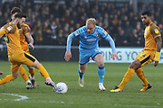 Josh Sheehan, Ryan Broom and Joss Labadie during the EFL Sky Bet League 2 match between Newport County and Cheltenham Town at Rodney Parade, Newport, Wales on 1 January 2020.