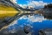 Rocky Mountains and Colin Ridge reflected in Medicine Lake at sunset<br /> Jasper National Park<br /> Alberta<br /> Canada