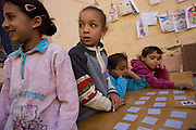 Local schoolchildren play memory card games at the American-sponsored Theban Mapping Project Library on the West Bank of Luxor, Nile Valley, Egypt. The Theban Mapping Project's goal is to enable local people to have a place where they can read and learn. The organisation is run by American Egyptologist Dr Kent Weeks who is committed to the original goal of accurately documenting the archaeological heritage of Thebes