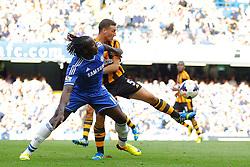 Chelsea's Romelu Lukaku and Hull City's James Chester compete for the ball  - Photo mandatory by-line: Mitchell Gunn/JMP - Tel: Mobile: 07966 386802 18/08/2013 - SPORT - FOOTBALL - Stamford Bridge - London -  Chelsea v Hull City - Barclays Premier League