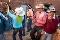 FESTEJANDO EL CARNAVAL EN EL PATIO DE UNA CASA DE ADOBE, JUIRI, QUEBRADA DE HUMAHUACA, PROV. DE JUJUY, ARGENTINA