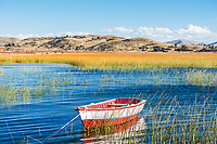 boat in Titicaca Lake in the peruvian Andes at Puno Peru