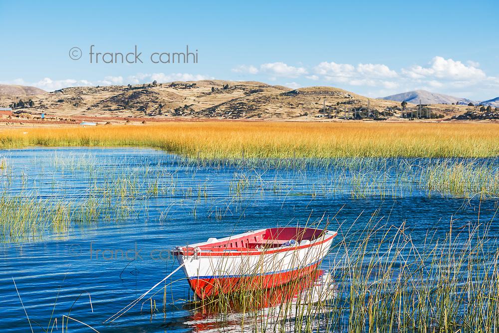 boat in Titicaca Lake in the peruvian Andes at Puno Peru