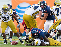 Virginia linebacker Clint Sintim (51) forces a fumble after sacking Georgia Tech quarterback Josh Nesbitt (9) late in the fourth quarter.  Virginia recovered the ball.  The Virginia Cavaliers defeated the #18 ranked Georgia Tech Yellow Jackets 24-17 in NCAA Division 1 Football at Bobby Dodd Stadium on the campus of Georgia Tech in Atlanta, GA on October 25, 2008.