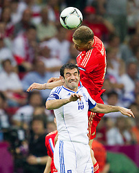 Giorgos Karagounis  of Greece vs Aleksei Berezutski of Russia during the UEFA EURO 2012 group A match between  Greece and Russia at The National Stadium on June 16, 2012 in Warsaw, Poland.  Greece defeated Russia 1-0 and qualified to Quarterfinals. (Photo by Vid Ponikvar / Sportida.com)