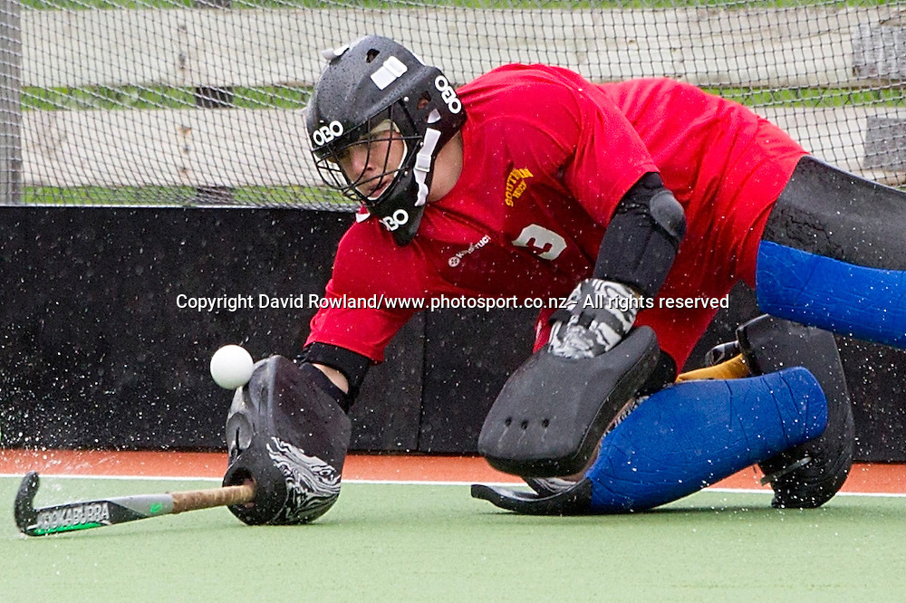 Southern`s goalkeeper Hamish McGregor makes a save in the Auckland v Southern Men`s semi-final match, Ford National Hockey League, North Harbour Hockey Stadium, Auckland, New Zealand,Saturday, September 13, 2014. Photo: David Rowland/Photosport