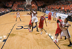 Virginia guard/forward Mamadi Diane (24) goes up for a shot against UMD.  The Virginia Cavaliers defeated the Maryland Terrapins 91-76 at the University of Virginia's John Paul Jones Arena  in Charlottesville, VA on March 9, 2008.