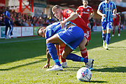 Curtis Tilt of Blackpool and Dion Charles of Accrington  contest a loose ball  during the EFL Sky Bet League 1 match between Accrington Stanley and Blackpool at the Fraser Eagle Stadium, Accrington, England on 21 September 2019.
