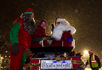 Santa and Mrs. Claus arrive by sleight to light up the Christmas tree in Stewart Park following the Holiday Parade on Sunday evening.  (Karen Bobotas/for the Laconia Daily Sun)