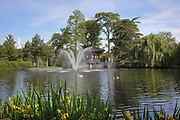 Pond with fountain at the Jardin d'Acclimatation in the Bois de Boulogne, in Neuilly-sur-Seine, opposite the 16th arrondissement of Paris, France. The garden is a children's amusement park originally opened as a zoo in 1860 by Napoleon III. The park was reopened in 2018 and features 40 attractions including 4 roller coasters, a zoo with 400 animals and 12 restaurants. Picture by Manuel Cohen