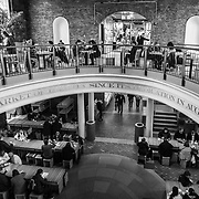 A high angle, black and white shot of the food court at Faneuil Hall Marketplace in Boston.