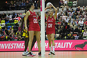England Women GA Helen Housby shooting and GS Helen Dunn during the Netball World Cup 2019 Preparation match between England Women and Uganda at Copper Box Arena, Queen Elizabeth Olympic Park, United Kingdom on 30 November 2018.