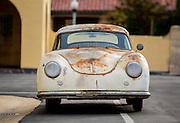 A few wrinkles in life make the journey more interesting, Image of a rusty old 1952 pre-A 356 Porsche in southern California, America west coast