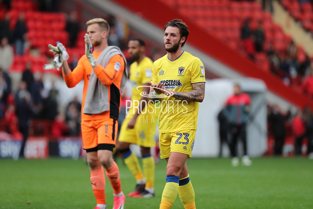 AFC Wimbledon defender Callum Kennedy (23) clapping during the EFL Sky Bet League 1 match between Charlton Athletic and AFC Wimbledon at The Valley, London, England on 28 October 2017. Photo by Matthew Redman.