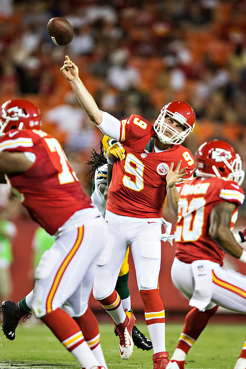 KANSAS CITY, MO - AUGUST 29:  Tyler Bray #9 of the Kansas City Chiefs is hit while throwing a pass during the last preseason game against the Green Bay Packers at Arrowhead Stadium on August 29, 2013 in Kansas CIty, Missouri.  (Photo by Wesley Hitt/Getty Images) *** Local Caption *** Tyler Bray
