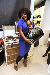 Singer ALISHA BENNETT 2007 X Factor finalist at the MCM Christmas party held at their store at 5 Sloane Street, London on 26th November 2008.