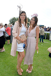 Left to right, LADY NATASHA RUFUS-ISAACS and LAVINIA BRENNAN at the 2014 Glorious Goodwood Racing Festival at Goodwood racecourse, West Sussex on 31st July 2014.