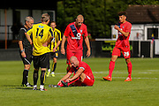Russ Penn is fouled by goalscorer Lloyd Kerry during the Friendly match between Harrogate Town and York City at Wetherby Road, Harrogate, United Kingdom on 25 July 2015. Photo by Simon Davies.
