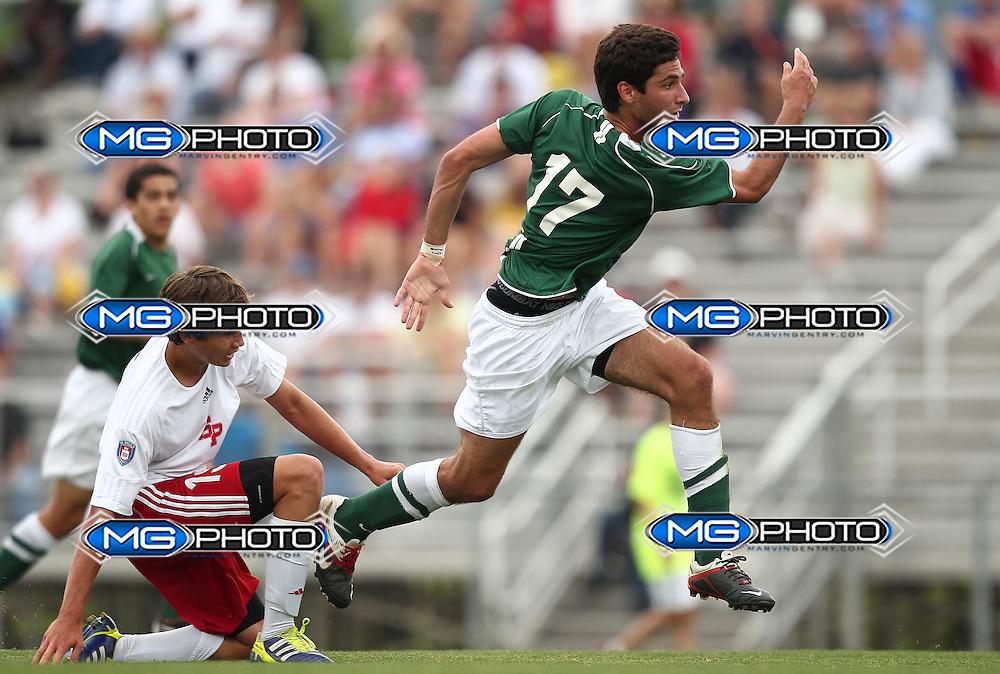 May 12, 2012; Huntsville, AL, USA;  John Carroll's Marc Gonzalez (17) is grabbed by Saint Paul defender. Mandatory Credit: Marvin Gentry