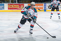 KELOWNA, CANADA - JANUARY 16: Riley Stadel #3 of Kelowna Rockets skates with the puck against the Seattle Thunderbirds on January 16, 2015 at Prospera Place in Kelowna, British Columbia, Canada.  (Photo by Marissa Baecker/Shoot the Breeze)  *** Local Caption *** Riley Stadel;
