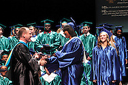 CJ president Daniel J. Meixner (and class of 1984) presents a diploma to Rayte'a Long  during the Chaminade Julienne High School Class of 2012 commencement exercises at the Schuster Center in downtown Dayton, Monday, May 21, 2012.
