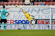 Wigan's keeper Jussi Jaaskelainen (22) at full stretch but cant stop the header from Derby's Bradley Johnson (15) to open the scoring 0-1 during the EFL Sky Bet Championship match between Wigan Athletic and Derby County at the DW Stadium, Wigan, England on 3 December 2016. Photo by Craig Galloway.