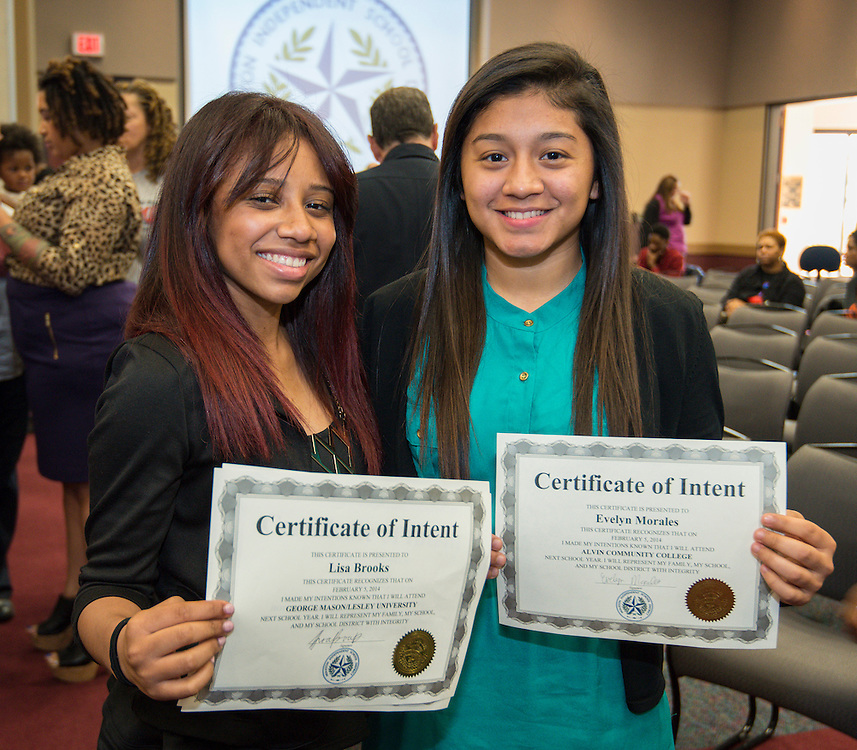 Chavez's Lisa Brooks (George Mason) and Evelyn Morales (ACC) pose for a photograph during a National Signing Day ceremony at the Region 4 Education Center, February 5, 2014.