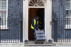 © Licensed to London News Pictures. 16/03/2020. London, UK. A delivery man wearing a hi-vis jacket marked Sainsburys enters No.10 Downing St with food and household items. Photo credit: Ray Tang/LNP