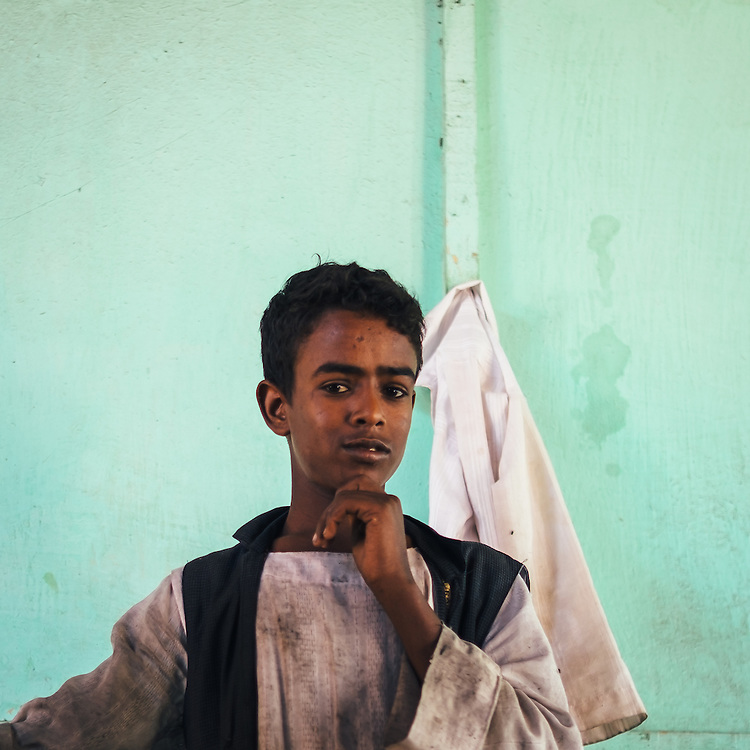 Hassan, a Bishari bedouin boy working in a small cafeteria in Abu Ramad.
