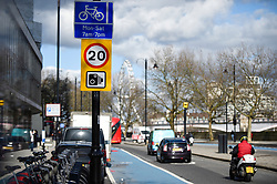 © Licensed to London News Pictures. 02/03/2020. LONDON, UK.  Traffic on Millbank passes by a 20 mile per hour sign.  A speed limit of 20mph has been imposed on all central London roads managed by Transport for London (TfL), under a scheme called Vision Zero, in a bid to reduce road deaths.  Effective 2 March, TfL roads within the congestion charge zone will be affected.  Photo credit: Stephen Chung/LNP