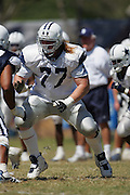 OXNARD, CA - AUGUST 8:  Offensive tackle Pat McQuistan #77 (seventh round pick in the 2006 NFL draft) of the Dallas Cowboys gets set to pass block during the Dallas Cowboys training camp on August 8, 2006 in Oxnard, California. ©Paul Anthony Spinelli *** Local Caption *** Pat McQuistan