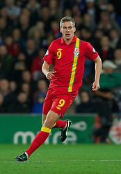 CARDIFF, WALES - Friday, October 12, 2012: Wales' Steve Morison in action against Scotland during the Brazil 2014 FIFA World Cup Qualifying Group A match at the Cardiff City Stadium. (Pic by David Rawcliffe/Propaganda)