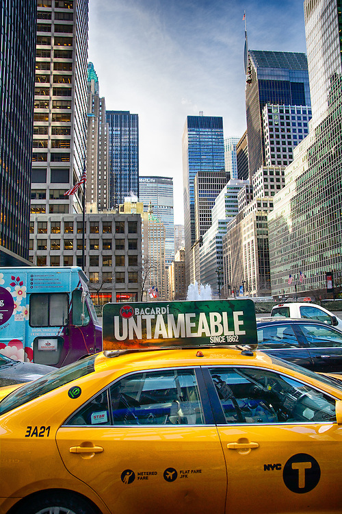 A New York Yellow Cab in front of skyline of New York