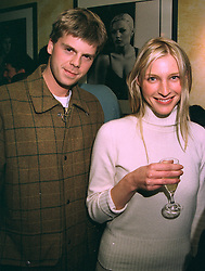 The HON.ORLANDO & MRS MONTAGU at a party in London on 22nd October 1997.MCJ 22