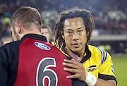 16 May, 2003. Jade Stadium, Christchurch, New Zealand. Super 12 Rugby Union, Semi Final, Crusaders v Hurricanes.<br />Hurricane captain Tana Umaga congratulates Reuben Thorne.<br />The Crusaders defeated the Hurricanes 39-16.<br />Pic: Andrew Cornaga/Photosport
