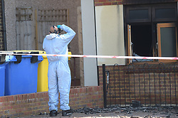 © Licensed to London News Pictures, 20/04/2018, Forensic officers at the scene of a block of nine assisted living flats in Connington Crescent, Chingford in East London, where fire had destroyed the roof and most of the interior of the flats. The alarm was raised around 2.15 am on Friday morning where  a female resident from the flats was found dead by emergency services; Photo credit: Steve Poston/LNP