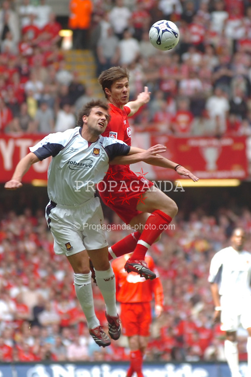 CARDIFF, WALES - SATURDAY, MAY 13th, 2006: Liverpool's Xabi Alonso and West Ham United's Carl Fletcher during the FA Cup Final at the Millennium Stadium. (Pic by Jason Roberts/Propaganda)