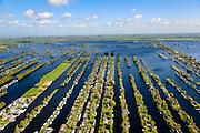 Nederland, Utrecht, Gemeente  De Ronde Venen, 09-04-2014; Vinkeveense Plassen met trekgaten en op de legakkers vakantiehuisjes. Legakkers zijn ontstaan door het afgraven van ht laagveen en werden gebruikt om het veen te drogen en turf te produceren (turven), de resterende stroken water zijn trekgaten.<br /> Water landscape as the result of peat extraction<br /> luchtfoto (toeslag op standard tarieven);<br /> aerial photo (additional fee required);<br /> copyright foto/photo Siebe Swart