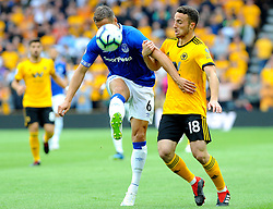 Phil Jagielka of Everton competes with Diogo Jota of Wolverhampton Wanderers - Mandatory by-line: Nizaam Jones/JMP - 11/08/2018/ - FOOTBALL -Molineux  - Wolverhampton, England - Wolverhampton Wanderers v Everton - Premier League