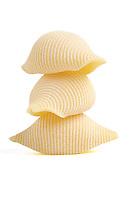 Conchiglie pasta on white background
