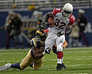 Arizona Cardinals running back Edgerrin James (32) brakes away from St. Louis Rams defensive end Leonard Little (91) in the first half, at the Edward Jones Dome in St. Louis, Missouri, December 3, 2006.  The Cardinals beat the Rams 34-20.<br />