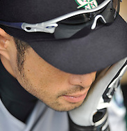 Ichiro sits in the dugout before leading off against the Indians in Cleveland.