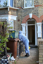 © Licensed to London News Pictures. 05/05/2020. London, UK. A forensic officer at a property in Dalmeny Road in Holloway, north London as police launch a <br /> murder investigation following the death of a pensioner. Police were called around 7:20pm on Monday, 4 May to reports of a man collapsed and suffering a head injury. Officers and London Ambulance Service attended. The 79-year-old man was pronounced dead at the scene and a 42-year-old man was arrested on suspicion of murder. Photo credit: Dinendra Haria/LNP