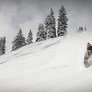 Chris Carpenter drops into monster powder in the Vail Backcountry of Colorado.