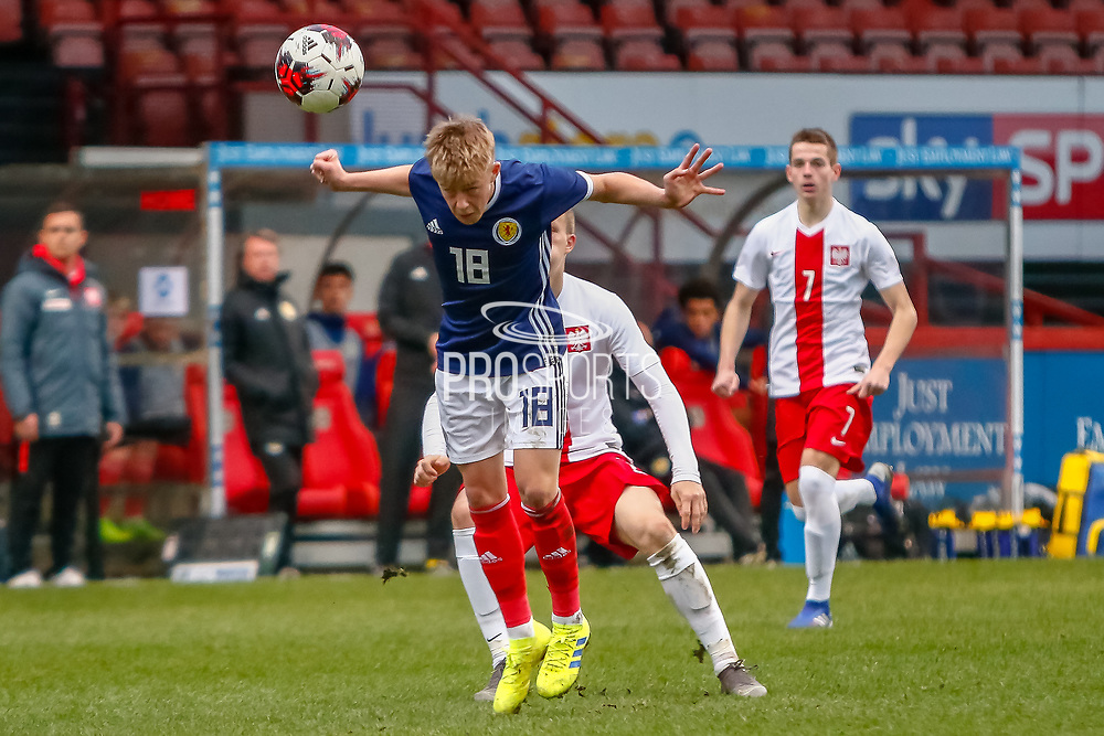 Connor Barron (Aberdeen) heads the ball during the U17 European Championships match between Scotland and Poland at Firhill Stadium, Maryhill, Scotland on 26 March 2019.