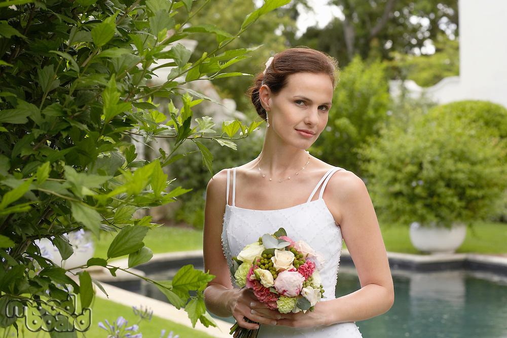 Bride in Formal Garden